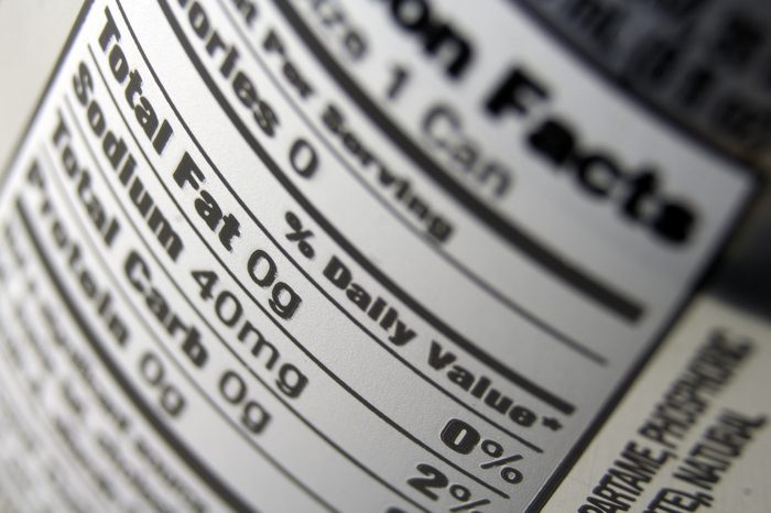 A close up of a nutritional value label on the back of a soda can