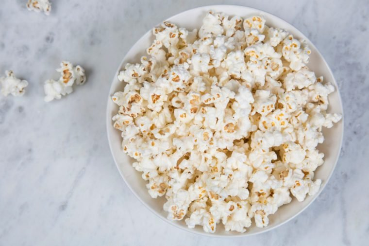Fresh homemade popcorn in a white bowl.