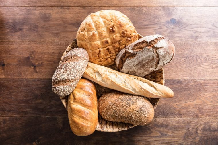 High Angle View Of A Variety Of Freshly Baked Bread In The Wicker Basket