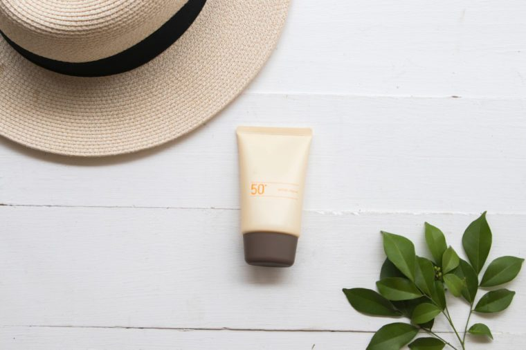 natural cosmetic for skin face sunscreen spf 50 of lifestyle woman in summer relax on background white