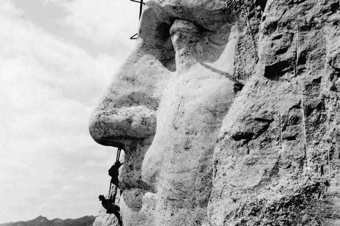 Mt. Rushmore, South Dakota: c. 1932. Workmen working on the face of George Washington on Mt. Rushmore.