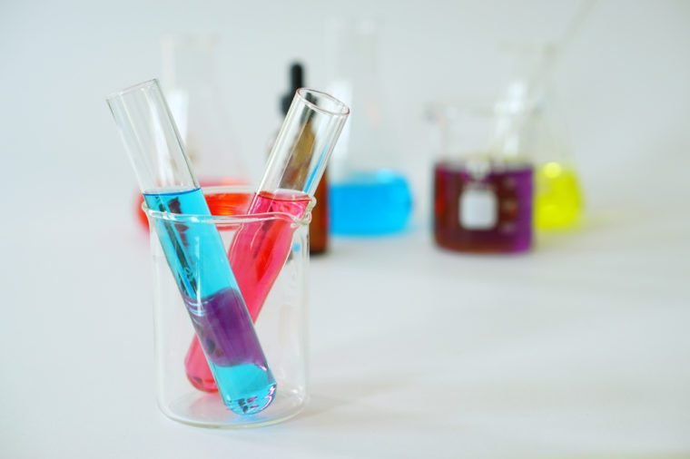 Group of Laboratory Equipment, Glass Erlenmeyer Conical Flask, Beaker and Test Tube filled with chemical liquid for a chemistry experiment in a science research lab.