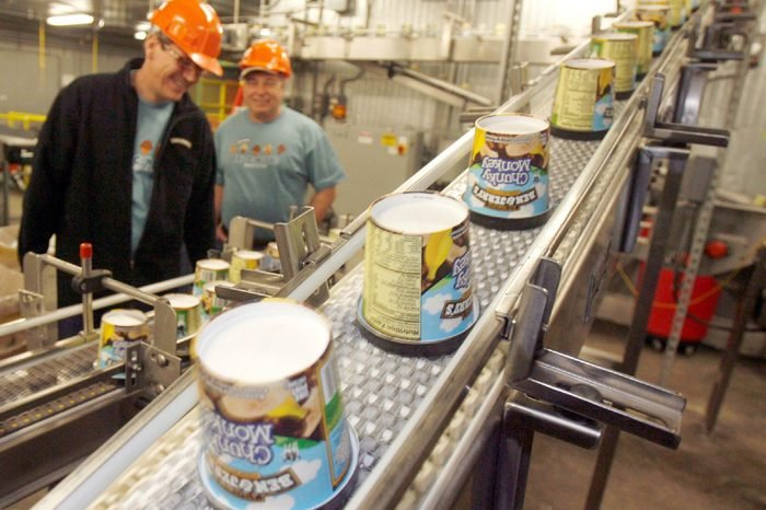 Ice cream moves along the production line at Ben & Jerry's Homemade Ice Cream in Waterbury, Vt. Ben & Jerry's is cutting about two dozen jobs at its Waterbury plant as part of a restructuring of its Vermont ice cream making operations