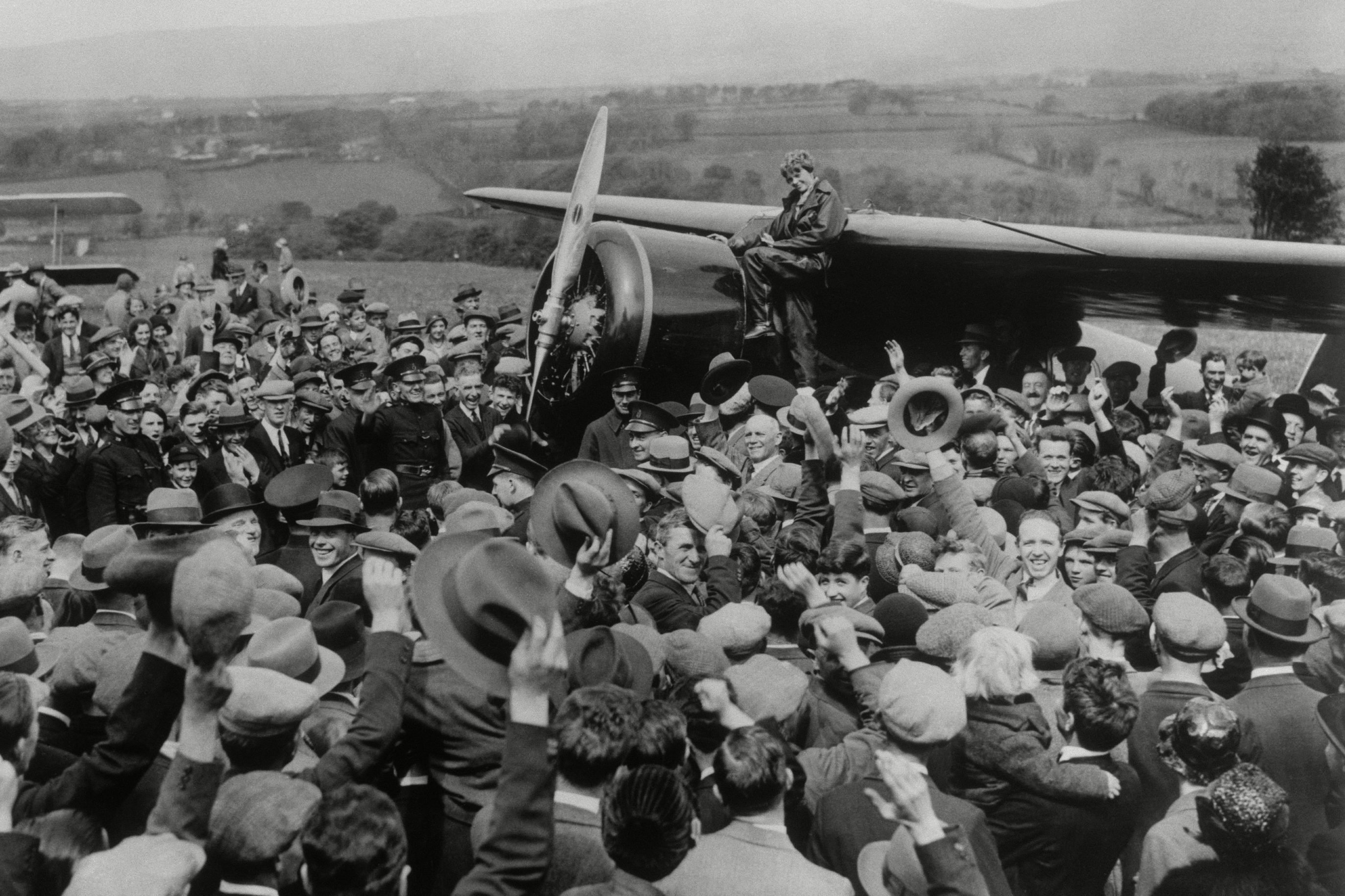 Mandatory Credit: Photo by Anonymous/AP/Shutterstock (7391973a) A crowd cheers for aviatrix Amelia Earhart as she boards her single-engine Lockheed Vega airplane in Londonderry, Northern Ireland, for the trip back to London on . Earhart became the first woman to fly solo nonstop across the Atlantic Ocean when she finished her 2,026 mile journey on May 21, 1932 in under 15 hours after departing from Harbour Grace, Newfoundland. Earhart vanished mysteriously over the Pacific during her attempted round-the-world flight in 1937 Amelia Earhart Solo Flight, Londonderry, United Kingdom