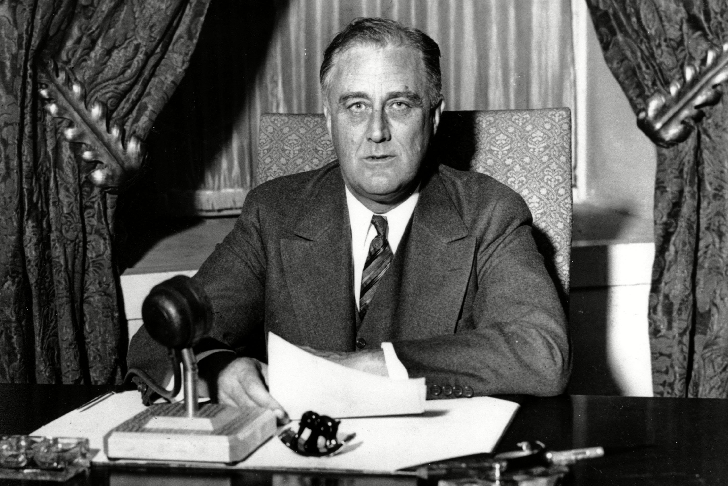 Mandatory Credit: Photo by AP/Shutterstock (7397466a) This photo was taken moments before U.S. President Franklin D. Roosevelt began his historic fireside chat to the American people on . He spoke to the nation on radio from the White House in Washington, D.C. Roosevelt explained in simple language the measures he is taking to solidify the nation's shaky banking system. The speech had a resounding success: millions of Americans began making bank deposits once again FDR FIRESIDE CHAT