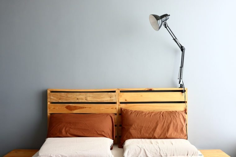 Loft bedroom with lamp turned off.