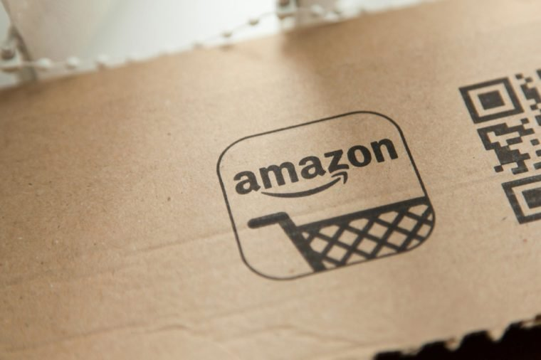 Amazon logo on a parcel. Amazon is the largest online retailer in the world and was founded in 1994