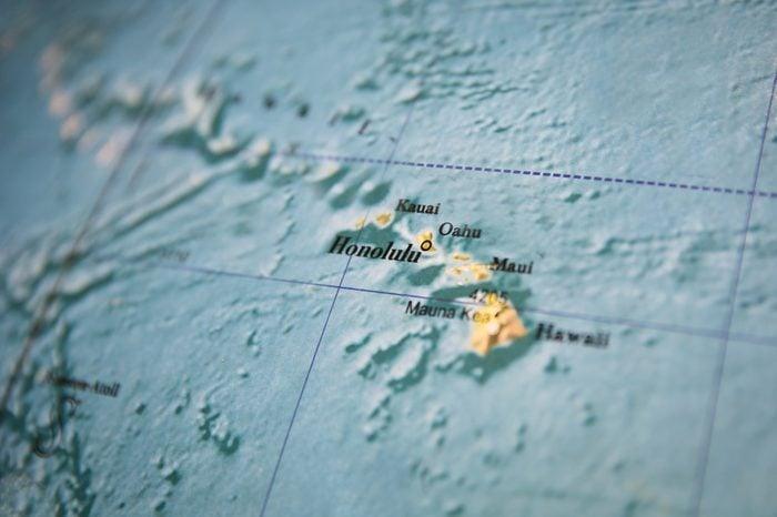 Hawaii map part of a world globe