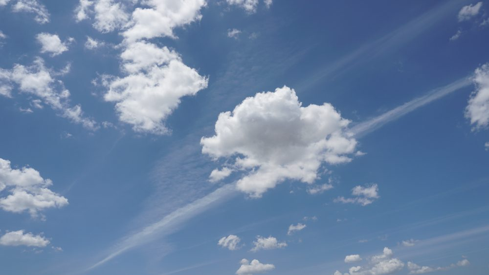 Small cumulus humilis clouds with clearly defined edges.
