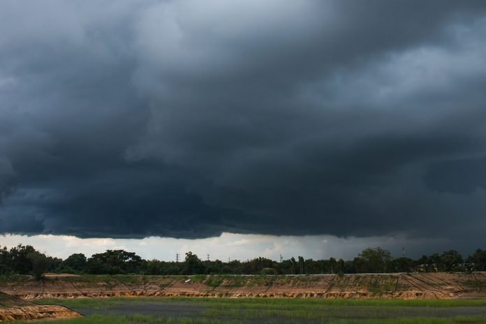 nimbostratus clouds /it was beginning to rain above the pool/ countryside of Thailand
