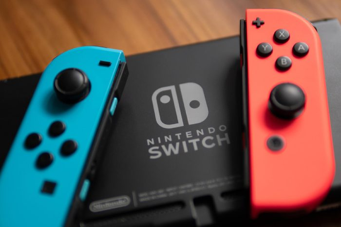 Nintendo Switch controller, was placed beside the Nintendo Switch Logo.