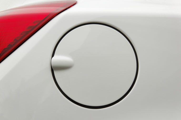 A close up of a petrol cap cover on a modern white car