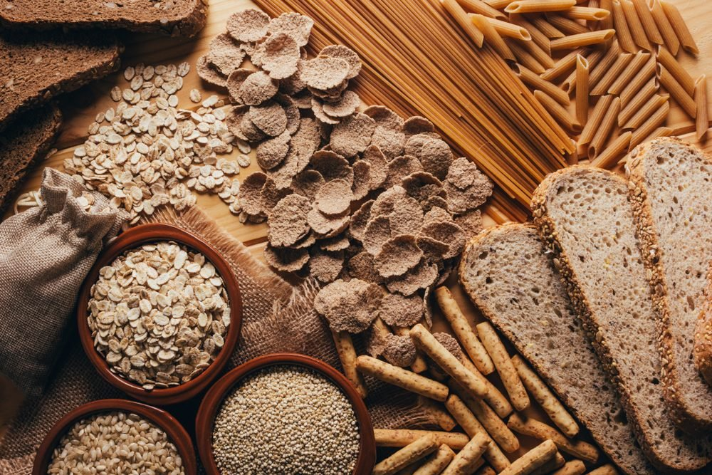 Wooden table full of fiber-rich whole foods, perfect for a balanced diet