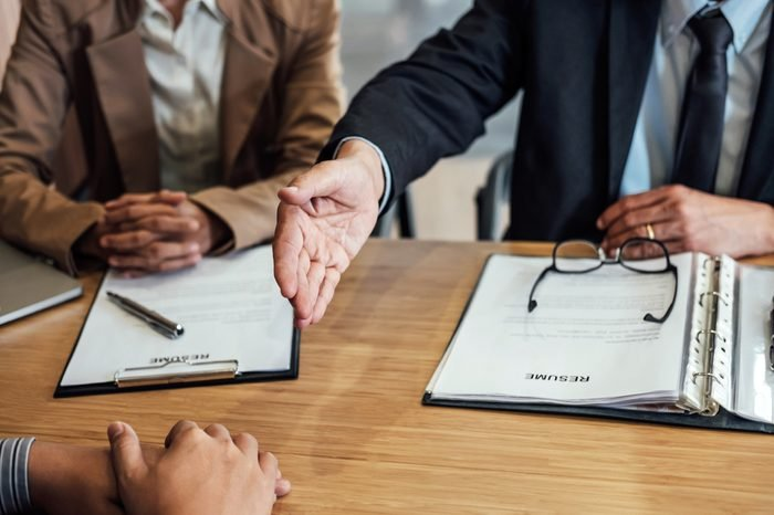 Welcome to colleagues, two senior manager shaking hands after during job interview, interview the job and hiring concept.