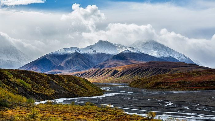 The braided channels of the Toklat river meanders through colorful Autumn foliage in Denali National Park, Alaska.
