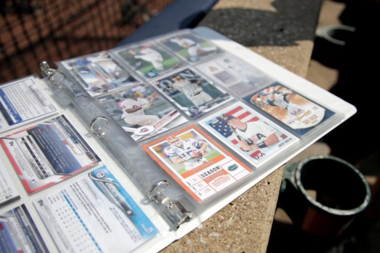 A trading card showing Tim Tebow's likeness in a Florida football uniform is seen with other trading cards from a child prior to the Eastern League All-Star minor league baseball game, in Trenton, N.J