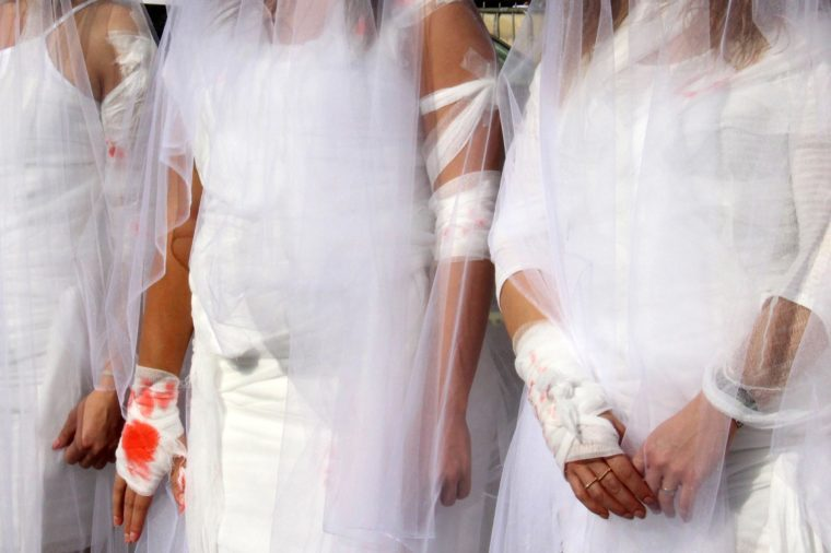 Activists From the Lebanese Ngo Abaad (arabic For Dimensions) a Resource Center For Gender Equality Dress As Brides and Wearing Injury Patches During a Protest Against Article 522 in the Lebanese Penal Code at Downtown Beirut Lebanon 06 December 2016 According to the Article Rapists Are Obligated to Marry Their Victims to Avoid Prosecution Which is Still Practiced in the Conservative Part of the Country and Especially Among Families Whose Priorities Are Headed by Preserving the Family's So-called 'Honor' Lebanon Beirut