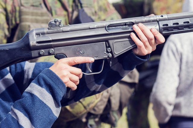 ak 4 rifle in boy's hands
