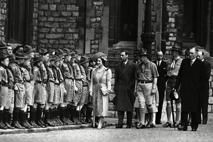 Britain's King George VI and Queen Elizabeth inspects the ranks of Scouts at the National Boy Scout rally in the grounds of Windsor Castle, on St. George's Day, . The royal family reviewed the Scouts before the dedication service to scout ideals in the chapel of St. George, attached to the castle. Scout troops and old Scouts attended the rally. This year great weight was given to the dedication service by the movement, at a time when, they feel, the Scout spirit is most wanted in the world