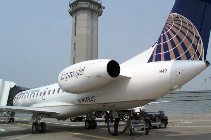 CONTINENTAL EXPRESS A Continental Expressjet sits at a gate at Dallas' Love Field on . Continental Airlines, boosted by strong summer traffic and sale of its ExpressJet stock, swung to a profit of $133 million in the third quarter in contrast to a loss a year earlier. But its chief executive said the carrier still faces tough times ahead