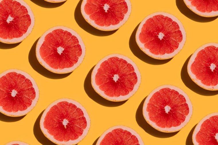 Grapefruit pattern on yellow background. Minimal flat lay concept.