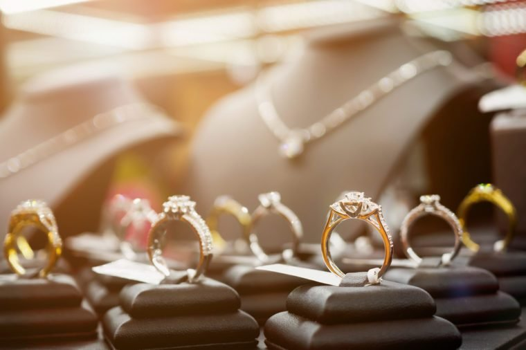 Jewelry diamond rings and necklaces show in luxury retail store window display showcase