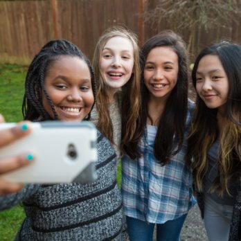 The Hidden Health Danger of Taking Selfies with Friends