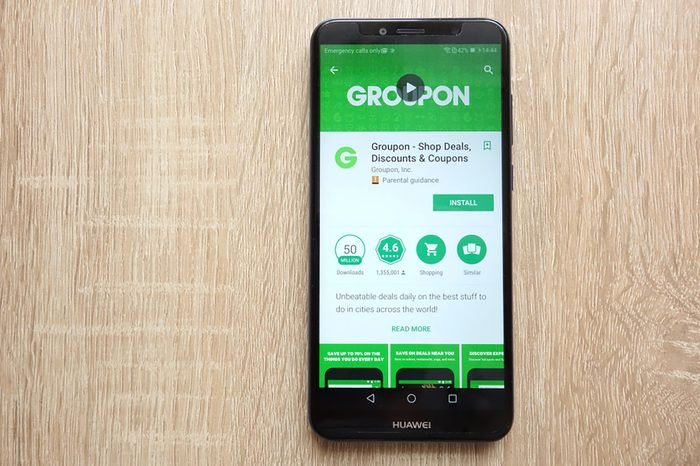 KONSKIE, POLAND - JUNE 17, 2018: Groupon - Shop Deals, Discounts and Coupons app on Google Play Store website displayed on Huawei Y6 2018 smartphone