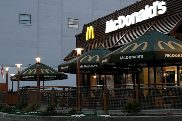 Kostanay, Kazakhstan, July, 2018. The McDonald's restaurant building is in the morning or evening light. No people.