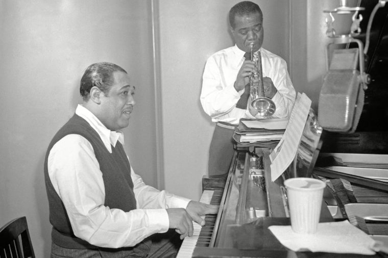 """Louis Armstrong, Duke Ellington. Jazz trumpeter Louis Armstrong and pianist Duke Ellington rehearse Leonard Feather's song """"Long, Long Journey"""" at the RCA Victor recording studio in New York City on . This is the first time Armstrong and Ellington have made a recording together"""