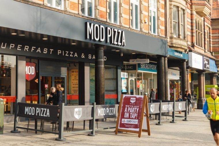 People walk past MOD Pizza restaurant in Nottingham. In Nottingham, England. On 13th February 2017.