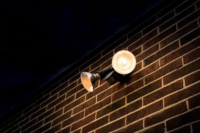 Flood light on external brick wall nighttime look up