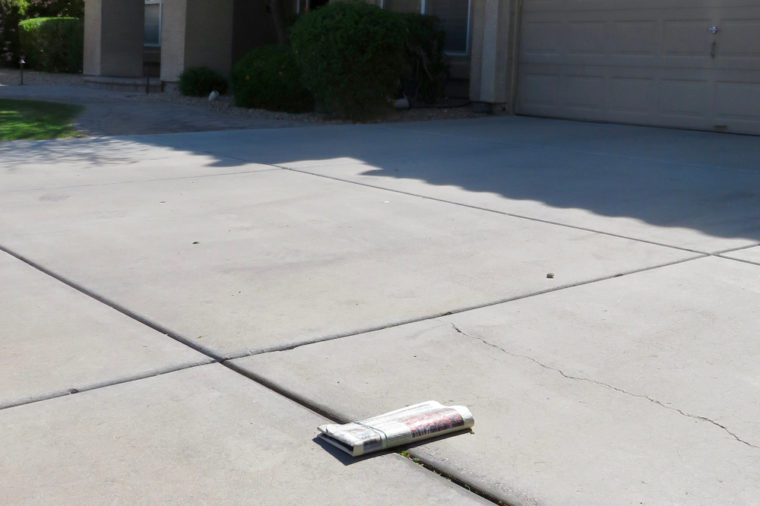 Newspaper delivered in driveway