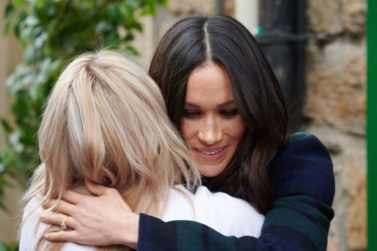 Meghan Markle hugging someone