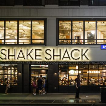 Shake Shack near Herald Square in Manhattan. Shake Shack is a trendy food chain known for quality. People can be seen.