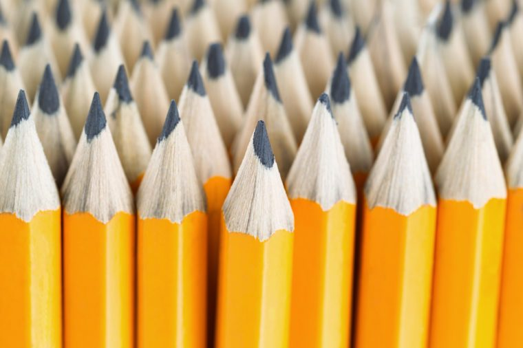 Close up front image of stacked pencils with focus on tip of centered pencil