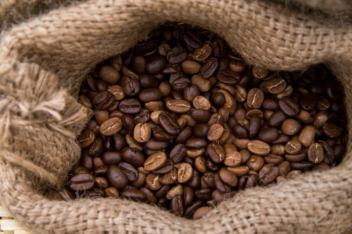 Roasted coffee beans. Coffee beans in coffee bag made from burlap