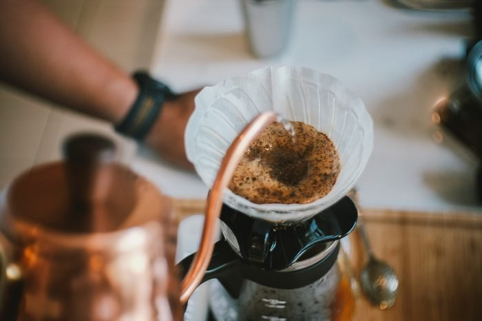 Barista brewing coffee, method pour over, drip coffee.