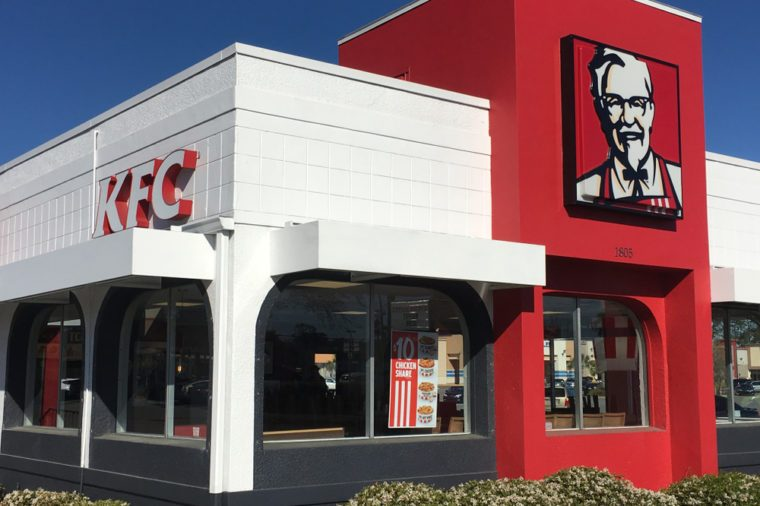 KFC Kentucky Fried Chicken retail restaurant store front with Colonel Harland David Sanders logo portrait sign Saint Augustine, Florida USA. March 8, 2018