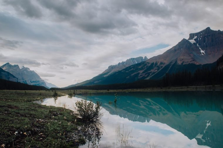 Glacier water reflection on Icefields Parkway, Alberta Canada