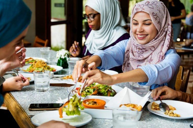Muslim women hijab having dinner
