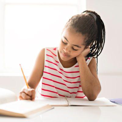 Black girl doing homework at home