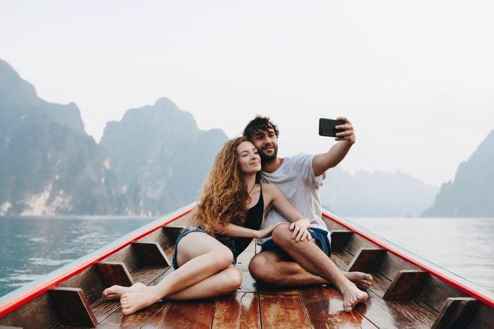 Couple taking selfie on a longtail boat