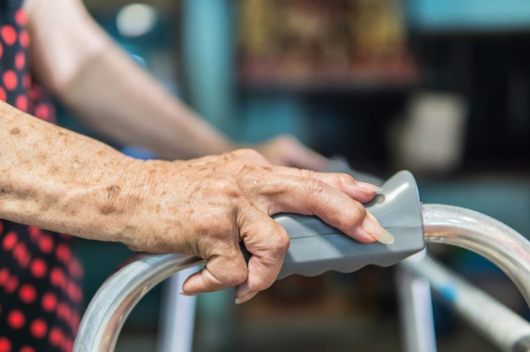 Elderly female patient hand and walker, Medical and healthcare concept.