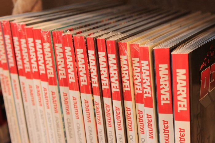 Marvel Comic Books in Row Close Up View. Many Various Comic Books with Marvel Heroes on Shelf at Book Store for Sale.