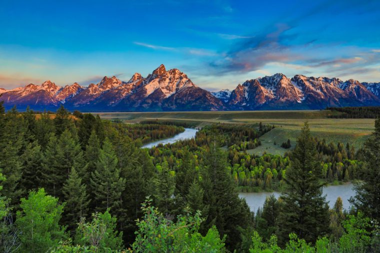 Sunrise from the Snake River Overlook in Wyoming with the Grand Tetons in the background.