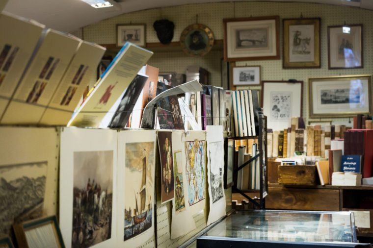An old vintage shop selling second hand books and antique paintings.