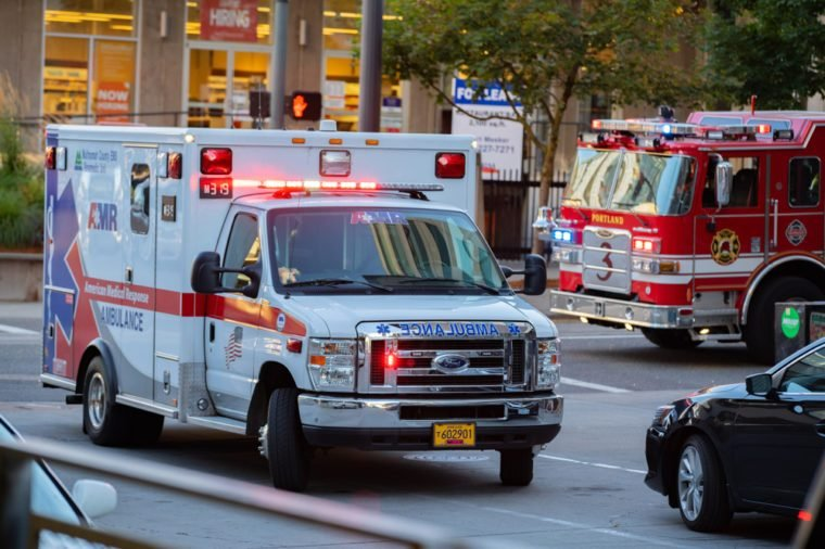 Ambulance and firefighter trucks block the street in downtown.