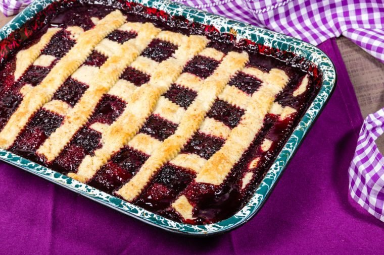 Fresh homemade marionberry cobbler in pan