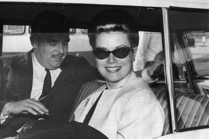 Prince Rainier Of Monaco With Wife Princess Grace / Grace Kelly In Car Leaving London Airport 1963.